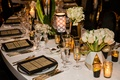 White table gold flatware black and gold place setting white vase tulips calla lily gold candles