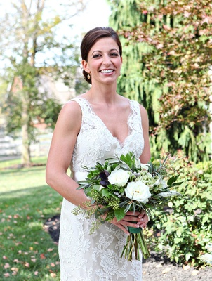 Rustic wedding bouquet with lots of greenery and white flowers
