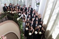 Wedding party on staircase at beverly hills hotel tuxedos and black dresses mismatched necklines