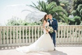 wedding couple bride and groom trumpet wedding dress groom in navy blue bow tie bel air bay club