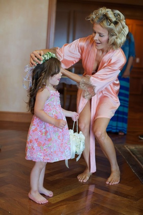 Joanna Krupa putting flower crown on flower girl