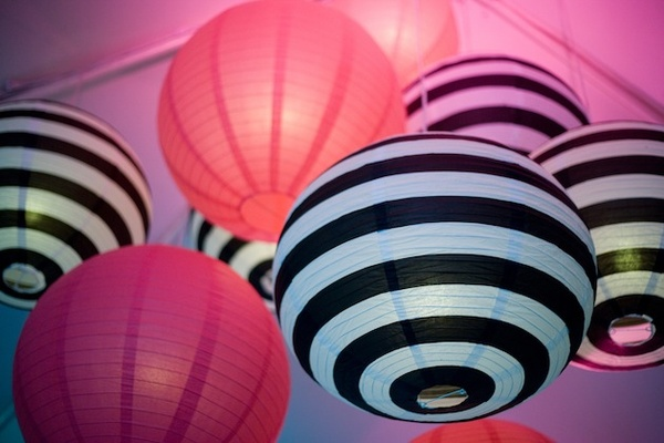Black-and-white striped paper lanterns and pink spheres