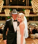 bride in inbal dror mermaid wedding dress with tim mcgraw at wedding reception