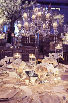 elegant wedding centerpiece, crystal candelabra with orchids and roses