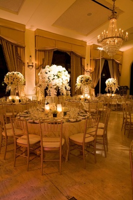 Golden ballroom décor and chandelier
