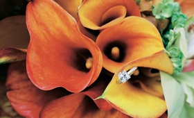 Princess engagement wedding ring on orange calla lily