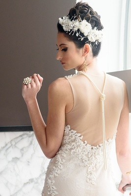 bridal headpiece with white flowers and crystals, pearl cluster ring, pearl back necklace