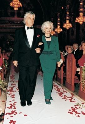 Groom's parents walk down the aisle