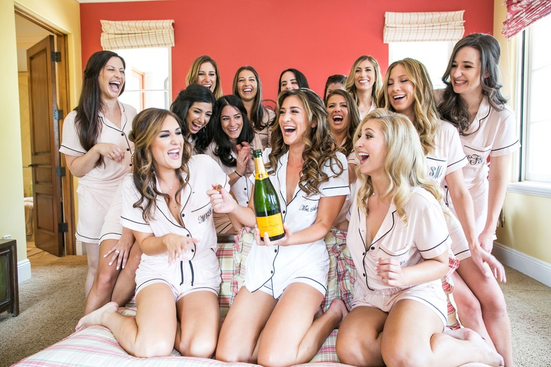 bride with veuve clicquot champagne and bridesmaids in summer pajama short sleeve shorts set