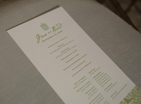 wedding program printed on white paper with green lettering