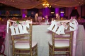 Gold chairs decorated with Mr. and Mrs. and flowers