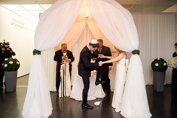 groom smashing glass ceremony modern jewish wedding chicago tradition fun newlyweds