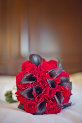 dramatic bridal bouquet red roses and black forest calla lilies