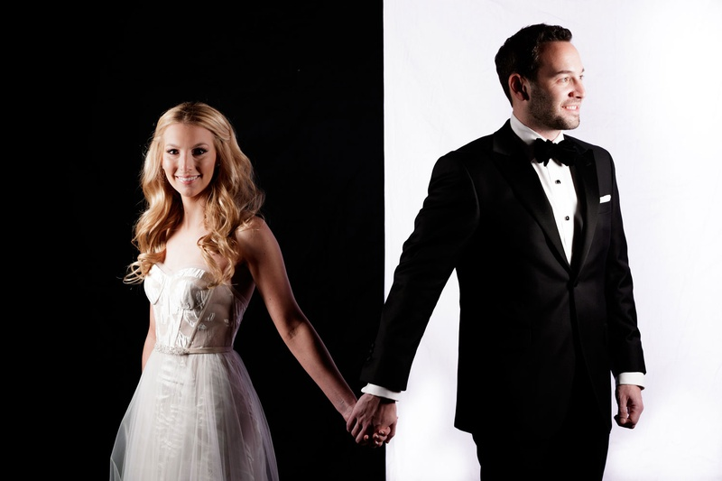 Cool mod modern portrait of bride on black background and groom on white background mira zwillinger