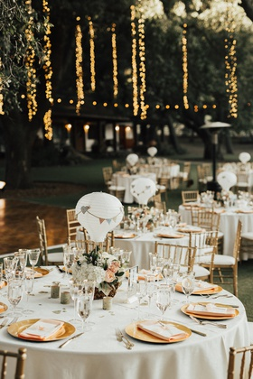 saddlerock ranch wedding reception with centerpieces made with paper lantern hot air balloons