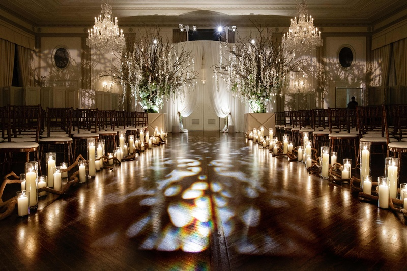All White Indoor Wedding Ceremony Site: Candlelit + All-White Ceremony