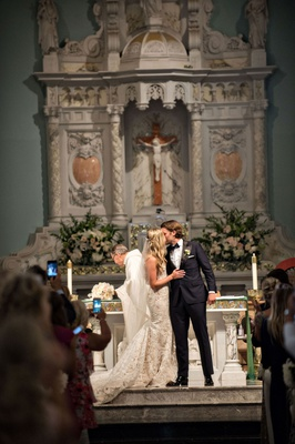 Wedding ceremony at catholic church in santa monica california marble altar ines di santo dress
