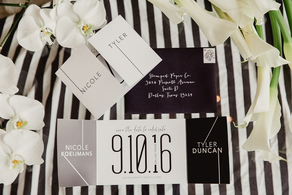 modern save the dates in black and white color scheme
