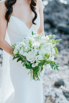 hawaii destination wedding bouquet white rose and other flowers greenery leaves structure crepe gown