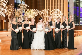 bride in lazaro ball gown, bridesmaids in mismatched black dresses, junior bridesmaid