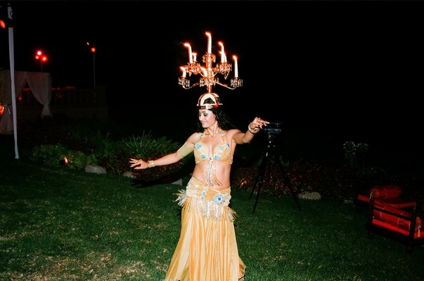 Belly dancers with candelabra on top of head