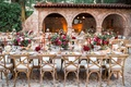 outdoor wedding reception in courtyard with vineyard chairs, fall wedding