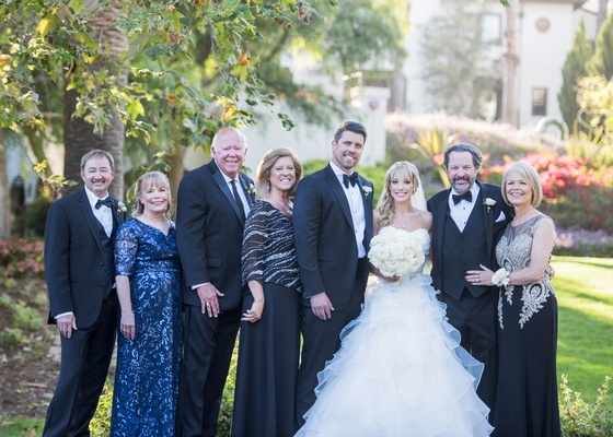 bride in fluffy ball gown, family portrait with blended family, wedding portrait with stepparents