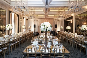 waldorf astoria chicago reception space with long mirror tables for guests