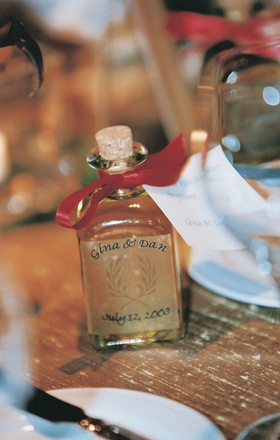 Bottle of olive oil with cork and red ribbon