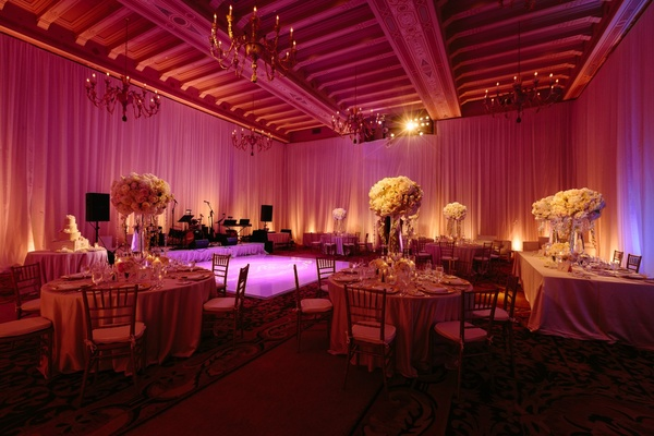 pink lighting, vintage spanish chandeliers, tall centerpieces
