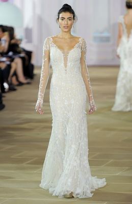 Long sleeve illusion neckline embroidered sheath gown with deep illusion back and signature side zip