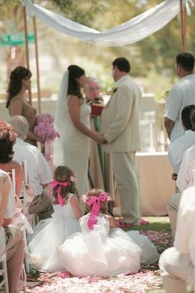 Little girls watching bride and groom get married