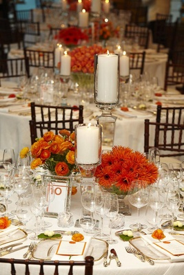 Orange and white wedding reception table decorations