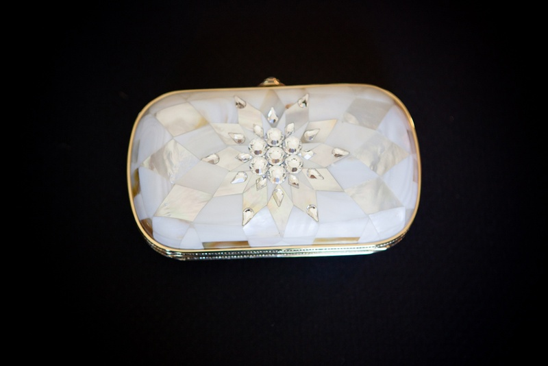 white clutch with geometric rose gold pattern and rhinestones