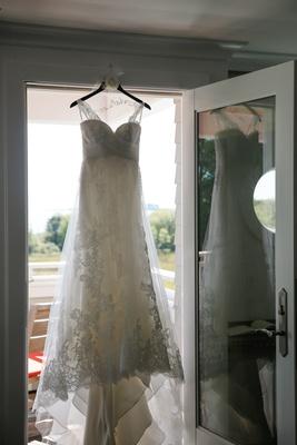 Pronovias wedding dress on custom hanger in doorway