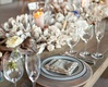 Wood reception table with coastal centerpiece and drift wood decor