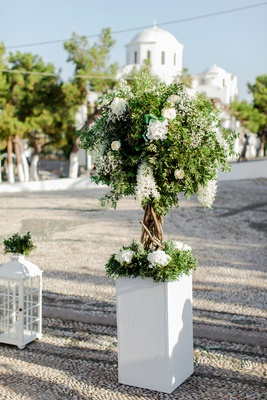 white box with ceremony arrangement, mini tree, white flowers
