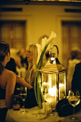 Tabletop lanterns with calla lilies attached