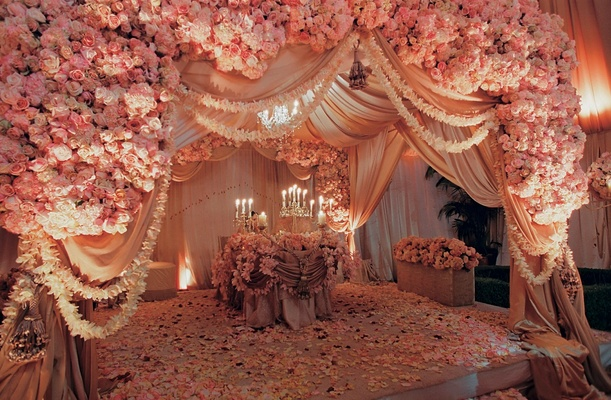 Moroccan middle eastern themed wedding in los angeles inside indian ceremony structure with pink flowers junglespirit