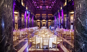 Marble columns and purple uplighting in foyer