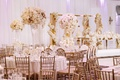 wedding reception royal wedding ideas white soft pink centerpiece gold chairs accents on tables