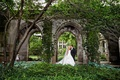 Bride in an Ines Di Santo dress kisses groom in black tuxedo in Fourth Presbyterian Church courtyard