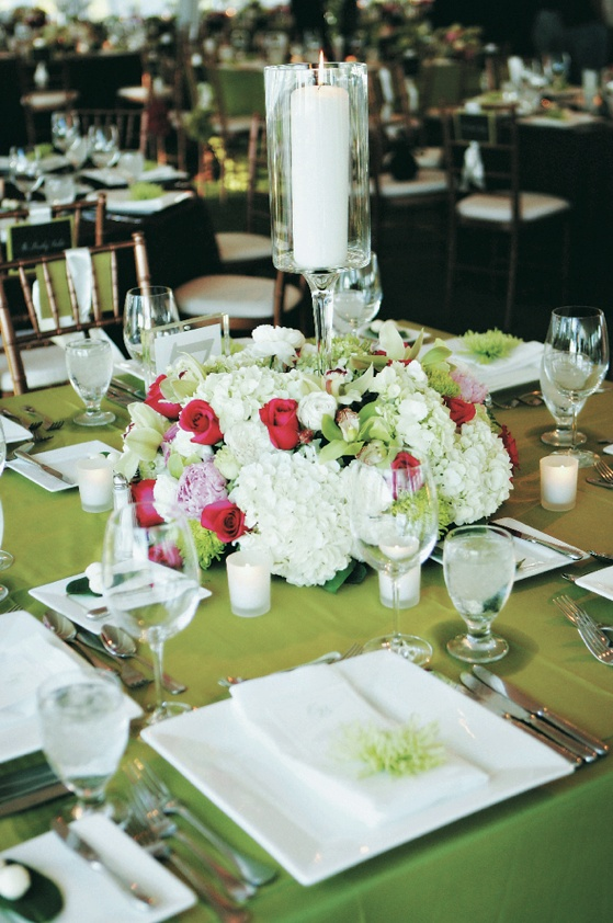 Square table with white plates and green tablecloth