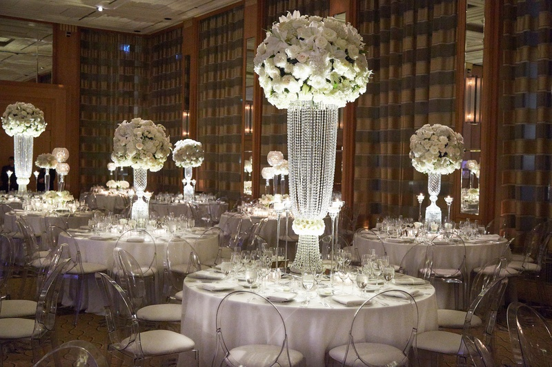 reception d cor photos centerpieces with white blossoms and crystal bases inside weddings. Black Bedroom Furniture Sets. Home Design Ideas