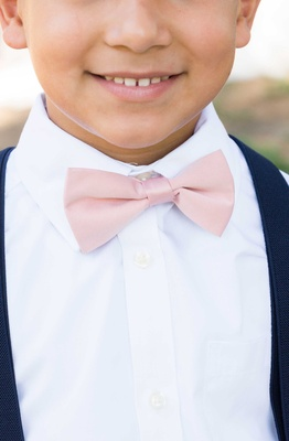 brides son pink bowtie ring bearer navy suit little boy catholic wedding