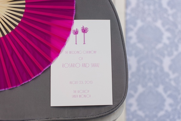 Hot pink fan and palm tree wedding program