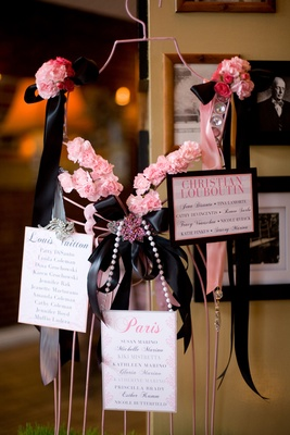pink centerpiece seating cards on vintage dress form