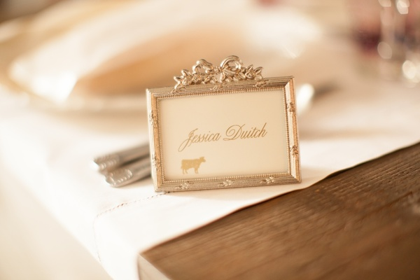 White and gold card in vintage bow frame