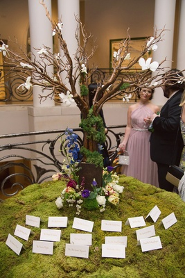 escort card table tree moss flowers dayton ohio wedding reception art institute garden indoor unique