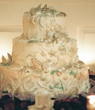 White three layer cake with ocean decor